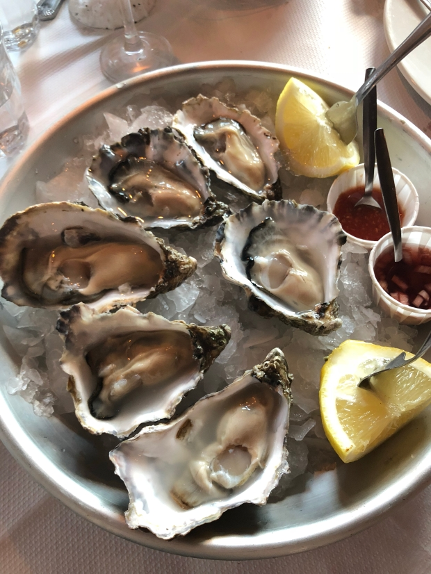 a plate of whitstable oysters with lemon