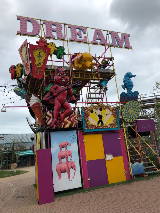 dreamland margate display with devil figure, dream sign and pink elephants
