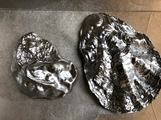 two oyster shells sprayed silver