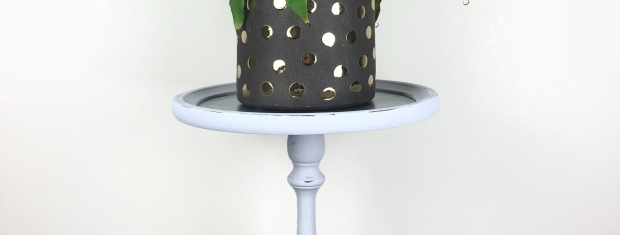 Painted plant stand with dark grey plant pot