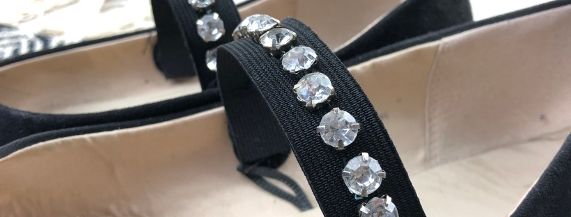 close up of jewels on elastic fixed to shoes
